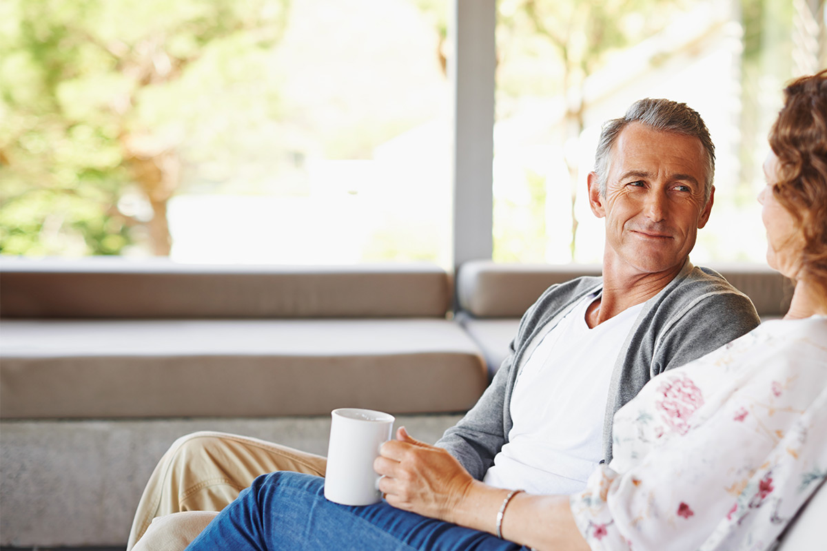 Couple discussing selling their house